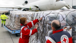 Workers of the German Red Cross prepare a load of humanitarian aid for victims of the earthquake in Nepal, in front of an aircraft at Schoenefeld airport outside Berlin