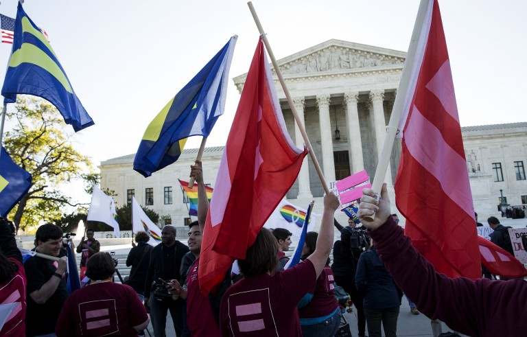 Same-sex marriage supporters rally in front of the Supreme Court Tuesday. The nine justices will hear arguments concerning gay marriage restrictions imposed in Kentucky, Michigan, Ohio and Tennessee. Photo by Joshua Roberts/Reuters