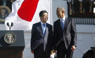 President Barack Obama and Japanese Prime Minister Shinzo Abe stand together during an official arrival ceremony for Abe on the White House South Lawn Tuesday. Photo by Jonathan Ernst/Reuters