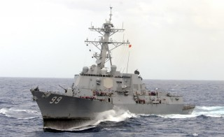 The guided-missile destroyer USS Farragut is shown in this undated photo operating in heavy seas in the Atlantic Ocean. Iranian forces boarded a Marshall Islands-flagged cargo ship in the Gulf on Tuesday after patrol boats fired warning shots across its bow and ordered it deeper into Iranian waters, the Pentagon said.  The closest U.S. warship was more than 60 miles away, he said, and the U.S. military instructed destroyer USS Farragut to head towards the cargo ship, which was passing through the Strait of Hormuz at the time.  Photo by Aaron Chase/Reuters/U.S. Navy/Handout