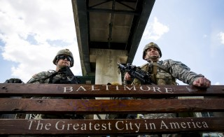 National Guard troops stand watch along E. Pratt St. in Baltimore, Maryland