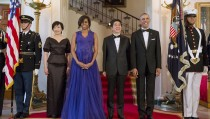U.S. President Barack Obama and first lady Michelle Obama welcome Japanese Prime Minister Shinzo Abe and his wife Akie Abe for a State Dinner at the White House