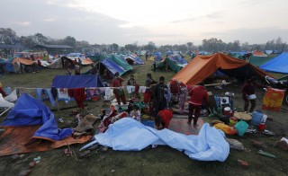 Makeshift shelters for earthquake victims are seen on an open ground in Kathmandu
