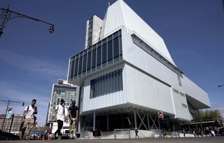 People walk past the new Whitney Museum of American Art in New York