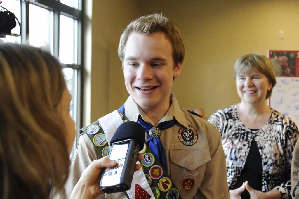 Pascal Tessier, then 16, from Kensington, Maryland, answers questions from the media while his mother, Tracie Felker (R), looks on after the resolution to allow openly gay scouts in the Boy Scouts of America passed in Grapevine, Texas May 23, 2013. The New York chapter of the Boy Scouts of America announced Thursday that it has hired Tessier as the first openly gay adult leader in the organizations 105-year history.  Photo by Michael Prengler/Reuters. REUTERS/Michael
