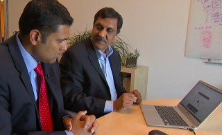 PBS NewsHour Weekend Anchor Hari Sreenivasan gets a tour of a massive, open online course (MOOC) from Anant Agarwal, president of EdX, a nonprofit provider MOOCs co-founded by  MIT and Harvard. (Photo: PBS NewsHour)