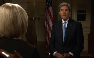 John Kerry and Judy Woodruff