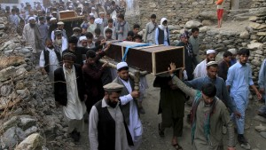 Relatives and residents carry the coffins of victims after a suicide attack during a burial ceremony in the Dari Noor district of Nangarhar province