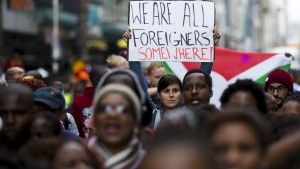 Hundreds of people participate in a peace march after anti-immigrant violence flared in Durban