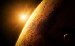 Planet Mars close-up with sunrise in space (Elements of this image furnished by NASA- texture map