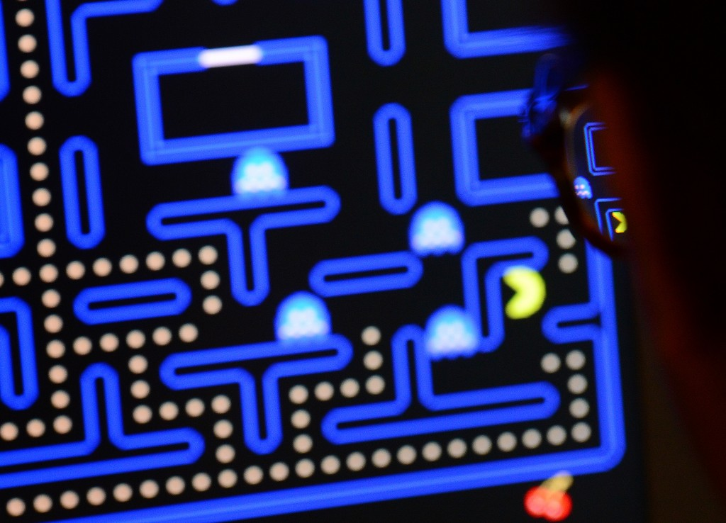 An employee plays the video game Pac-Man (1980) during an exhibition preview featuring 14 video games acquired by The Museum of Modern Art (MoMA)  in New York, March 1, 2013. The MoMA acquired 14 video games entering its collection as part of an ongoing research on interaction design. Photo by Emmanuel Dunand/AFP/Getty Images