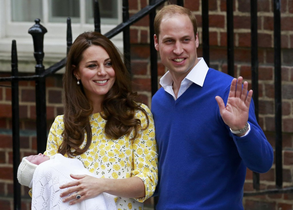 Britain's Prince William and his wife Catherine, Duchess of Cambridge appear with their baby daughter outside the Lindo Wing of St Mary's Hospital in London. Photo by REUTERS/Cathal McNaughton