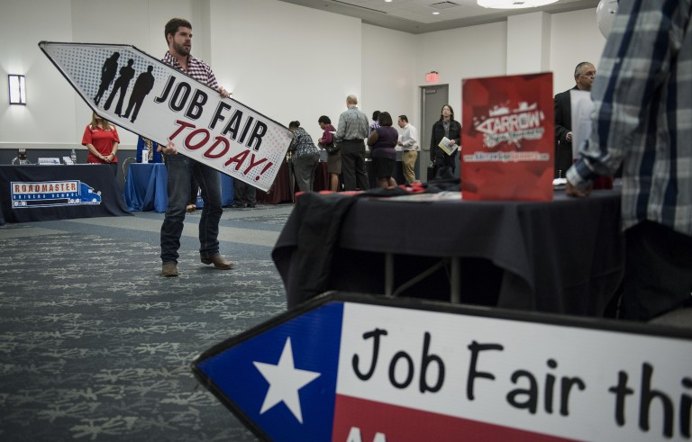 Kyle Nicely with Aarrow Sign Spinners advertises his job by spinning a job fair sign during the Choice Career Fair in San Antonio on Thursday, April 16, 2015. Jobless claims in the U.S. stayed below 300,000 last week according to a report by the Labor Department. Two hundred and ninety-five people attended Thursday's Choice Career Fair in San Antonio. Photo by Matthew Busch/Bloomberg via Getty Images