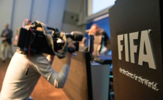 A cameraman attends a press conference  at the FIFA headquarters on May 27 in Zurich, Switzerland. Photo by Philipp Schmidli/Getty Images