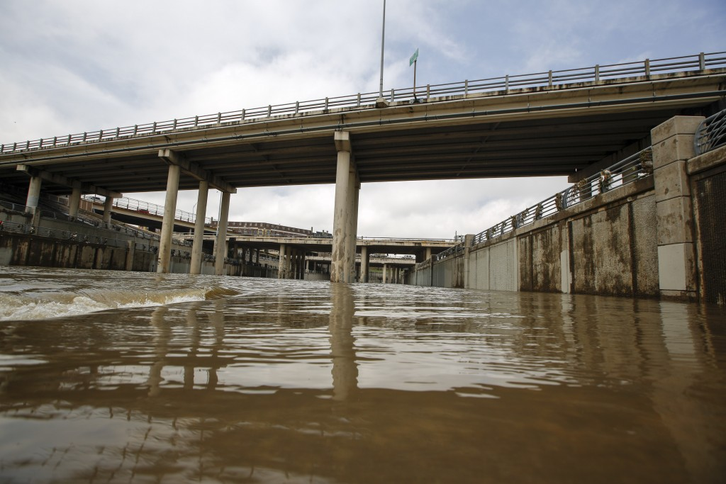 HOUSTON, TX - MAY 27: The Brays Bayou flows after massive flooding May 27, 2015 in Houston, Texas. At least 19 people have been killed across Texas and Oklahoma after severe weather, including catastrophic flooding and tornadoes, struck over the past several days, with more rain expected. Photo by Eric Kayne/Getty Images.