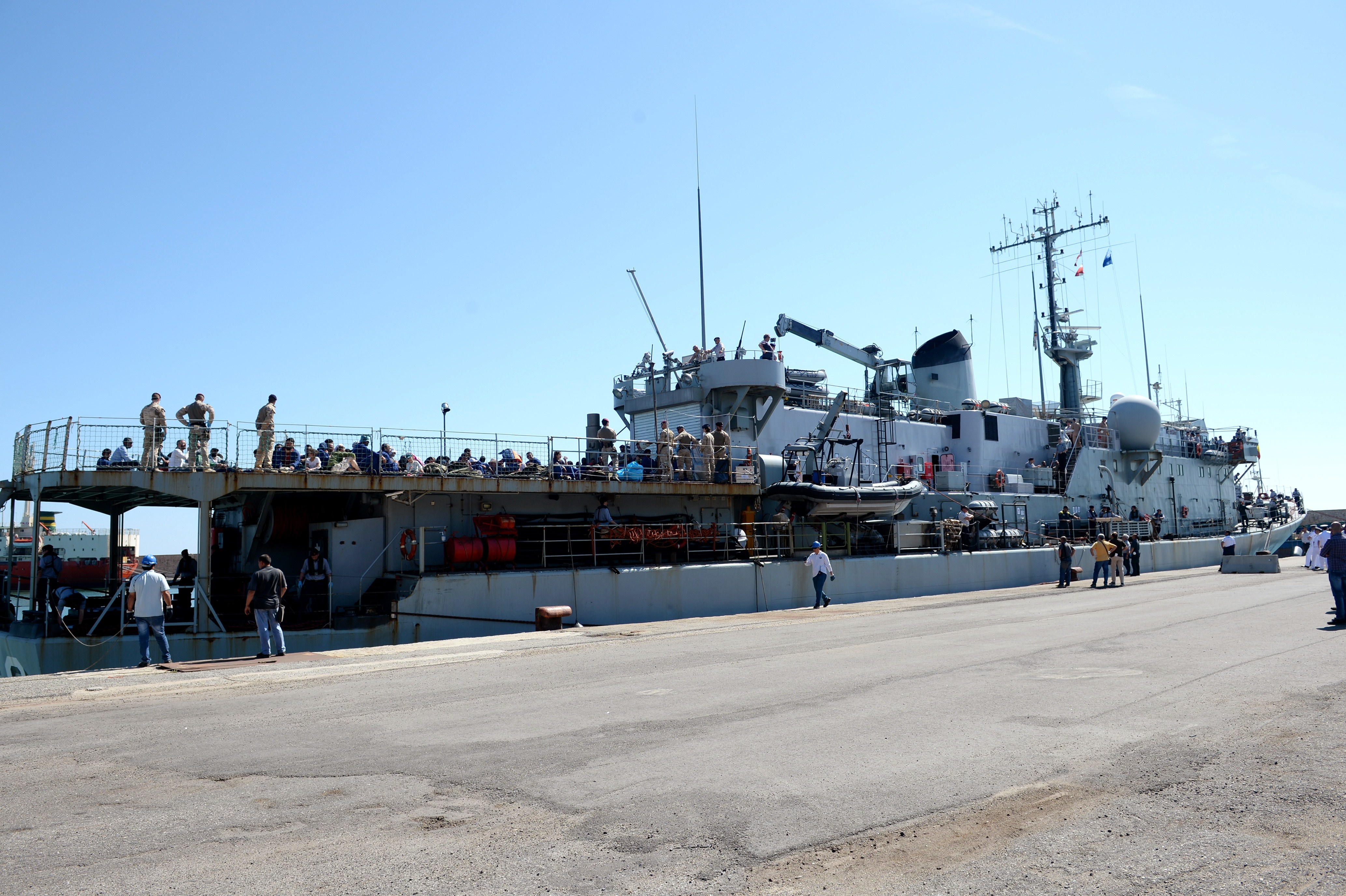 The Godetia logistical support ship of the Belgian Navy is docked on May 30, 2015 upon its arrival in the port of Crotone in the Italian southern region of Calabria after rescuing some 200 migrants, as part of Frontex-coordinated Operation Triton off the Italian coast. Photo by Alfonso di Vincenzo/Getty Images.