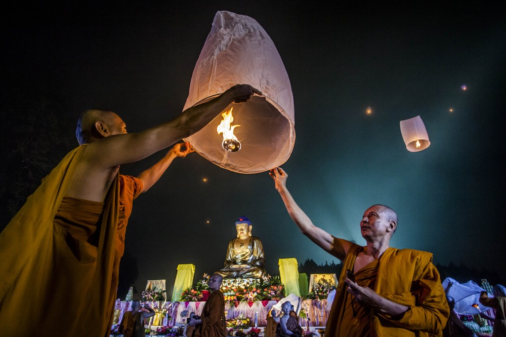 Buddhist monks release a lantern into the air at Borobudur temple during celebrations for Vesak Day on May 15, 2014 in Magelang, Central Java, Indonesia. Photo by Ulet Ifansasti/Getty Images