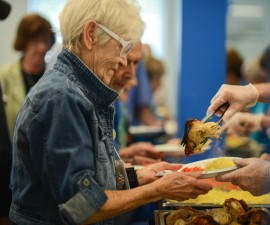 Dorothy Abruzzo, 83, receives hot lunch from JFCS Senior Center May 6, 2015 in Naples, FL. JFCS Senior Center provides a place for its members to socialize along with services and classes, five days a week. Every Wednesday, it provides a hot meal followed by entertainment. Photo by Ariel Min/PBS NewsHour