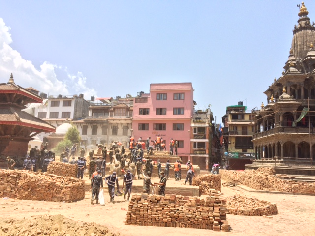 Nepali soldiers and police officers haul rubble and help clear debris at Patan Durbar Square, one of the UNESCO World Heritage sites damaged by the April 25 earthquake that rattled the Kathmandu Valley. Photo courtesy of Rohit Ranjitkar/Kathmandu Valley Preservation Trust.