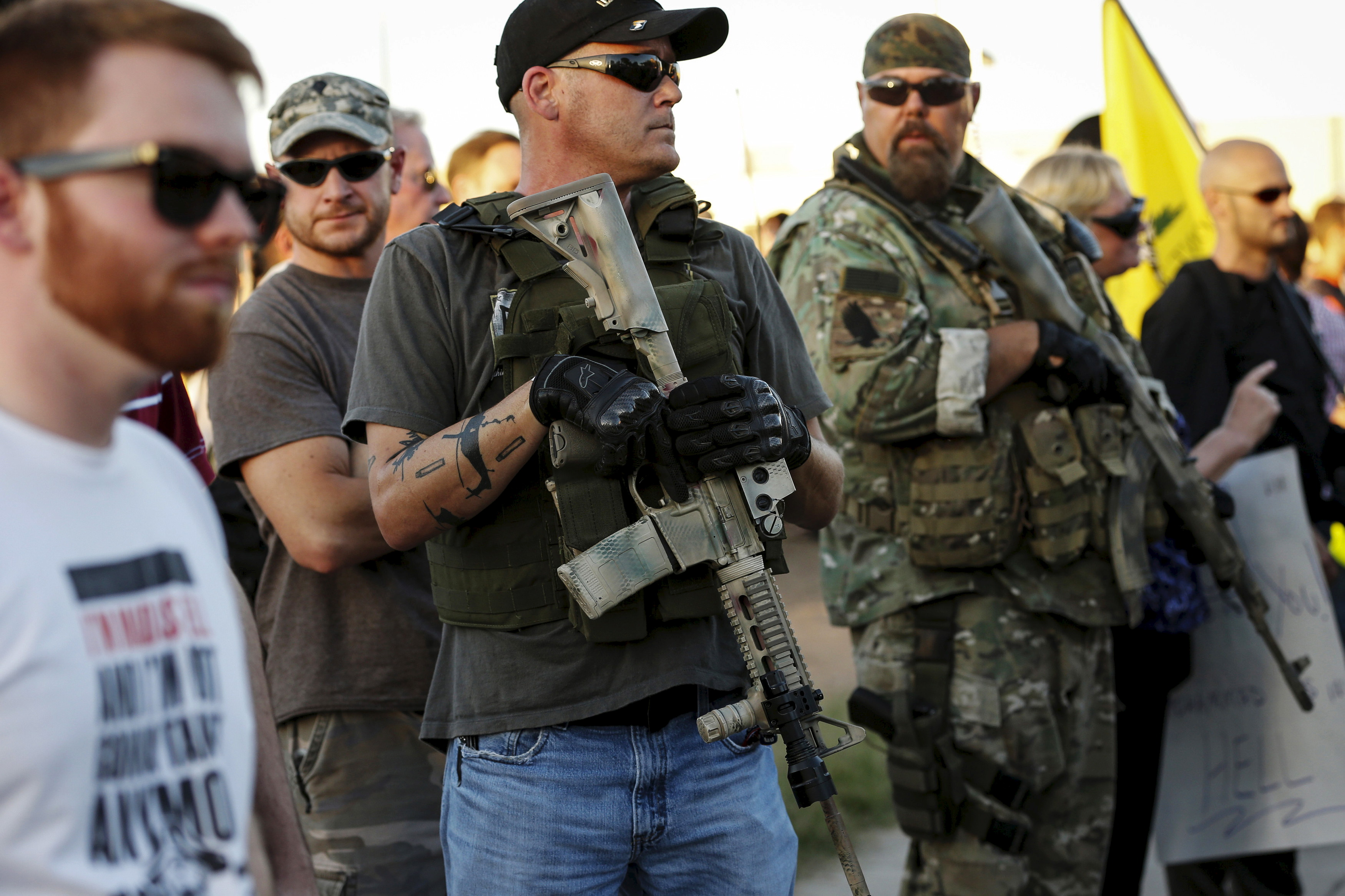 "Men carrying rifles attend a ""Freedom of Speech Rally Round II"" across from the Islamic Community Center of Phoenix, Arizona May 29, 2015. Photo by Nancy Wiechec/Reuters."