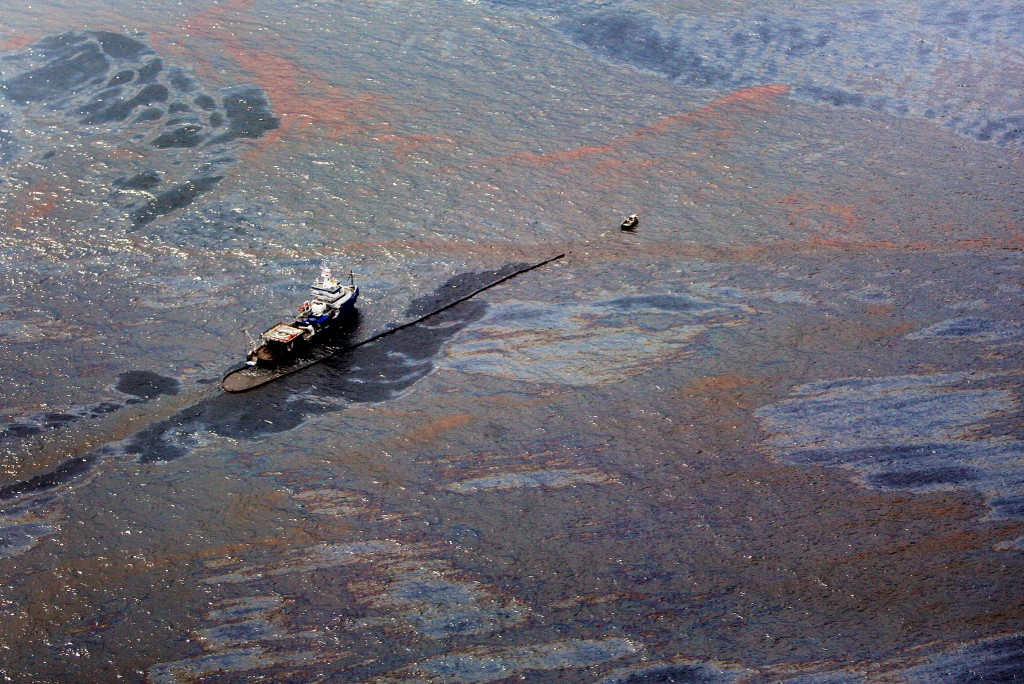 Oil floats on the surface of the Gulf of Mexico around a work boat at the site of the Deepwater Horizon oil spill in the Gulf of Mexico June 2, 2010. As the desperate effort to contain the gusher proceeded, the slick stretched farther. Tar balls and other oil debris from the giant, fragmented slick reached Alabama's Dauphin Island, parts of Mississippi and were less than 16 km (10 miles) from Florida's northwest Panhandle coast. Photo by Sean Gardner/Reuters