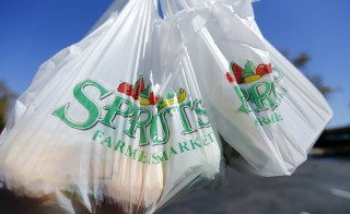 Groceries are carried in plastic bags in San Diego, California September 30, 2014. California signed the first-in-the-nation law to ban single-use plastic bags from grocery stores. In many cases, states like Missouri have stepped in after city officials somewhere in the nation proposed local policies that business leaders didn't like, such as the ban of single-use plastic bags from grocery stores. Photo by Mike Blake/Reuters.