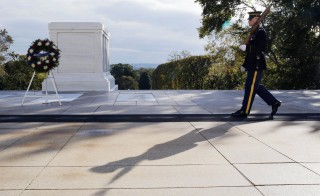 A member of the U.S. Army's 3rd United States Infantry Regiment protects the Tomb of the Unknown Soldiers in Arlington National Cemetery in Virginia