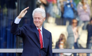 Former U.S. President Bill Clinton salutes the crowd before speaking on behalf of Kentucky's Democratic Senate candidate Alison Lundergan Grimes during a campaign event at The Muhammad Ali Center in Louisville, Kentucky October 30, 2014. Grimes is running against current Senate minority leader Mitch McConnell. Photo by John Sommers II/Reuters