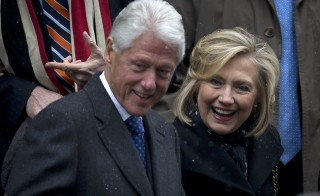 Former U.S. President Bill Clinton and former U.S. Secretary of State Hillary Clinton depart the former Governor of New York Mario Cuomo's funeral in Manhattan, New York January 6, 2015. A new report shows the Clintons together earned over $30 million in speaking fees and book royalties since January 2014. Photo by Carlo Allegri/Reuters.