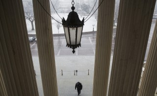 A Capitol Hill police officer walks up the steps of the Senate chamber on January 21, 2015. Capitol Police officers have left their weapons unattended and unsecured at least three times this year. Photo by Joshua Roberts/Reuters