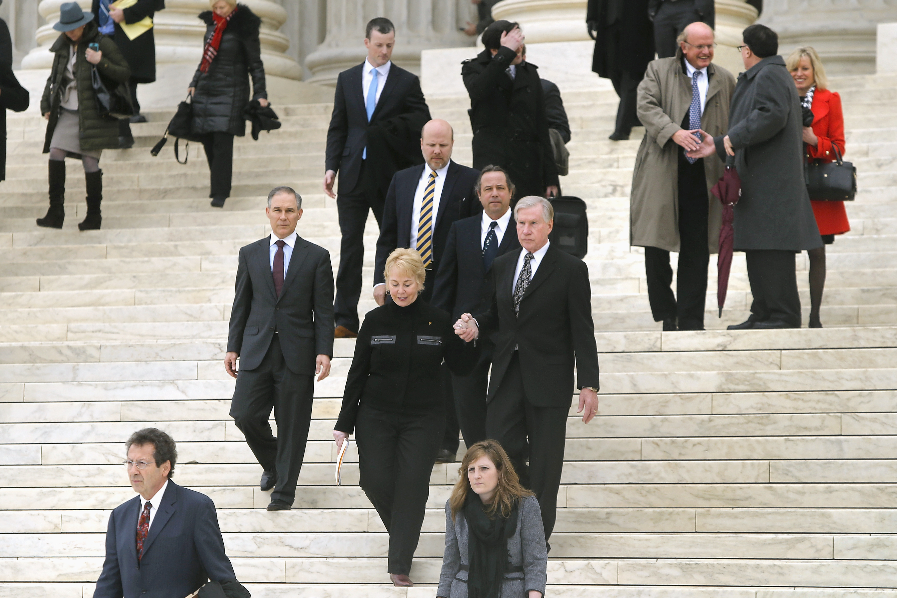 Members of the King v. Burwell plaintiffs' legal team exit the Supreme Court building after arguments in Washington, March 4, 2015. A recent poll shows few Americans have faith in the Court's ability to rule fairly on the case, which is the latest challenge to the Affordable Care Act.