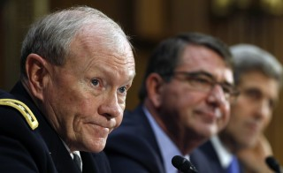 "Chairman of the Joint Chiefs of Staff Army Gen. Martin Dempsey (L), U.S. Defense Secretary Ash Carter (C) and Secretary of State John Kerry testify at a Senate Foreign Relations Committee hearing on ""The President's Request for Authorization to Use Force Against ISIS: Military and Diplomatic Efforts"" on Capitol Hill in Washington March 11, 2015. Despite major setbacks, the U.S. has maintained that its military operations against ISIS is working. Photo by Kevin Lamarque/Reuters."