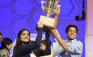 Vanya Shivashankar (L) of Olathe, Kansas, and Gokul Venkatachalam, St. Louis Missouri lift the trophy after becoming co-champions after the final round of the 88th annual Scripps National Spelling Bee at National Harbor, Maryland May 28, 2015.      REUTERS/Joshua Roberts      TPX IMAGES OF THE DAY      - RTR4XXUY