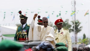Nigeria's new President Muhammadu Buhari rides on the motorcade while inspecting the guard of honour at Eagle Square in Abuja