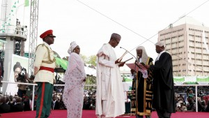 Chief Justice of Nigeria Mahmud Mohammed swears in Muhammadu Buhari as Nigeria's president while Buhari's wife Aisha looks on at Eagle Square in Abuja