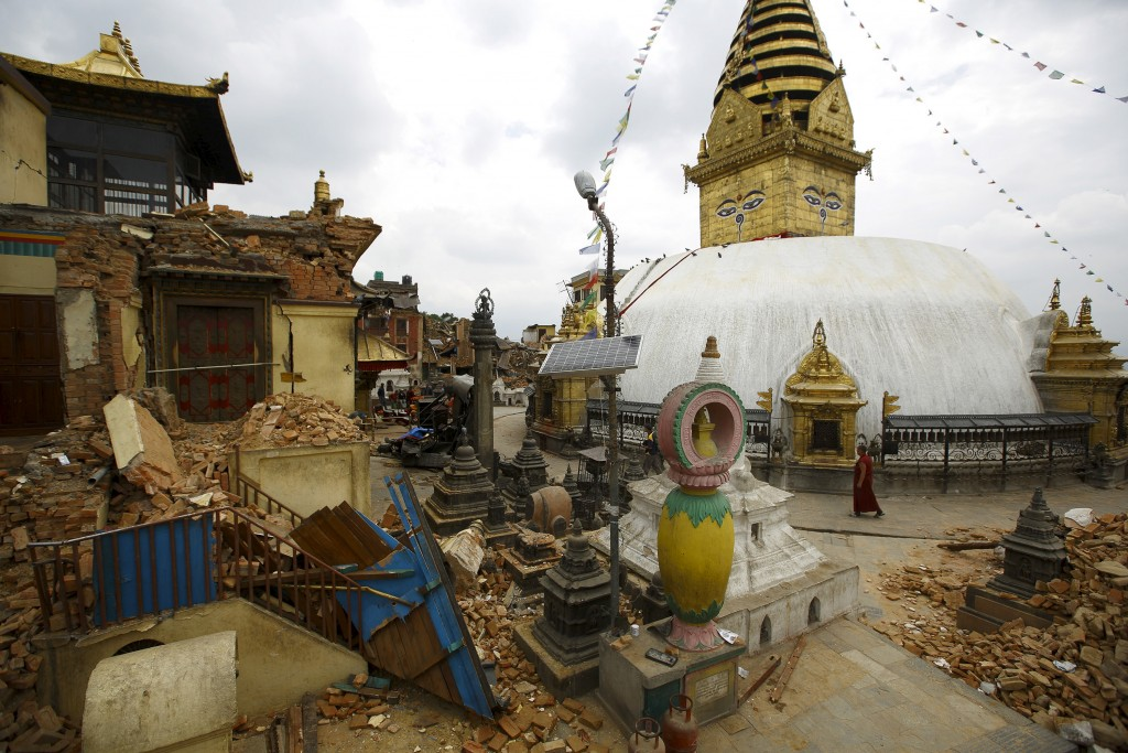 A monk walks past the collapsed monastery and shrines at Swayambhunath Stupa, a UNESCO world heritage site, days after a 7.8-magnitude earthquakes truck Kathmandu, Nepal. Also called the Monkey Temple, the complex is considered one of that country's oldest religious sites and holds spiritual significance for both Buddhists and Hindus. Photo by Navesh Chitrakar/Reuters.
