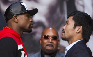 Undefeated WBC/WBA welterweight champion Floyd Mayweather Jr. (L) of the U.S. and WBO welterweight champion Manny Pacquiao of the Philippines face off during a final news conference at the MGM Grand Arena in Las Vegas