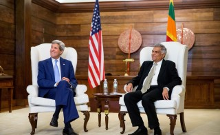 U.S. Secretary of State John Kerry (L) sits next to Sri Lankan Prime Minister Ranil Wickremesinghe in Colombo, Sri Lanka, May 2, 2015. Kerry's visit to Sri Lanka is the first by a U.S. Secretary of state in a decade. Photo by Andrew Harnik/Reuters