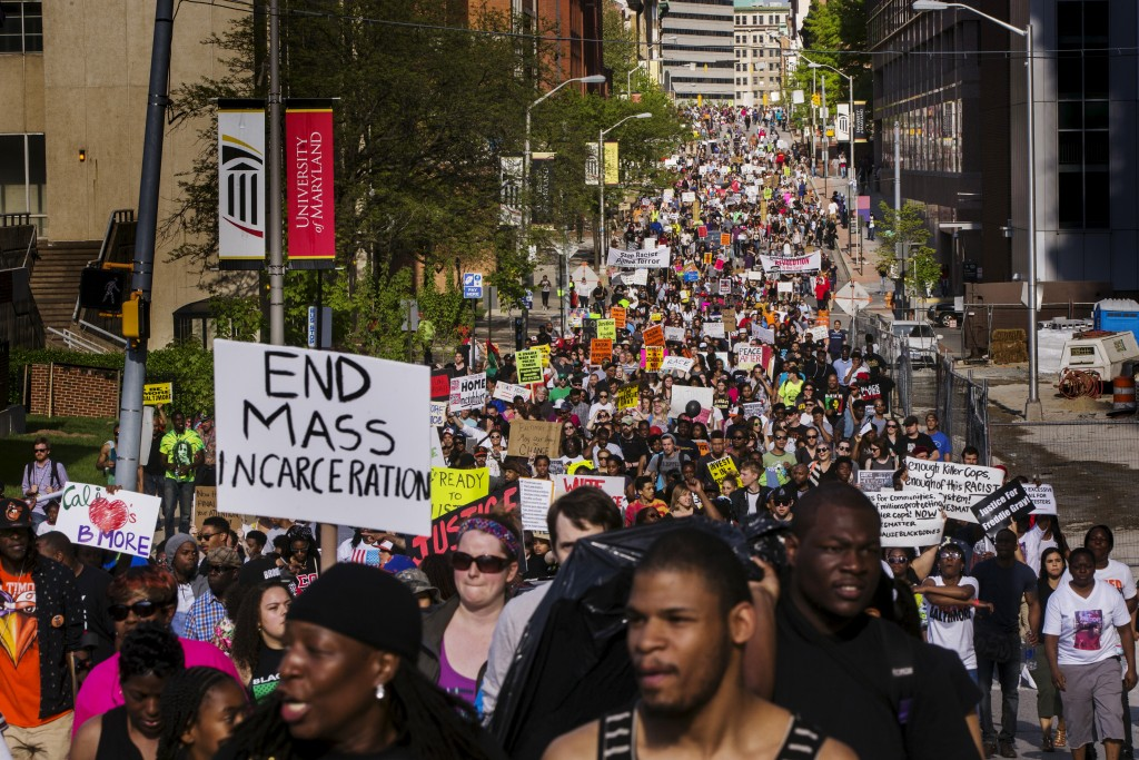 A large crowd marches from Baltimore City Hall to the scene of unrest earlier in the week, in Baltimore, Maryland May 2, 2015. Thousands of people took to the streets of Baltimore on Saturday as anger over the death of young black man Freddie Gray turned to hopes for change following swift criminal charges against six police officers. REUTERS/Lucas Jackson - RTX1BA9P