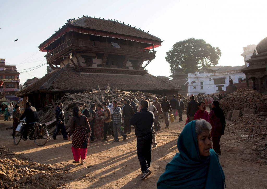 People walk through damaged Bashantapur Durbar Square, a UNESCO World Heritage Site, after an earthquake in Kathmandu, Nepal. The area is defined by old royal palace grounds and temples where people still worship despite the quake's damagePhoto by Danish Siddiqui/Reuters.