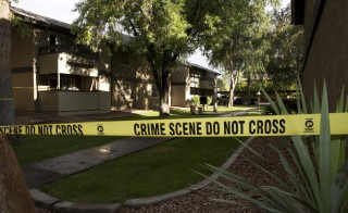 Crime scene tape surrounds buildings at the Autumn Ridge apartment complex which had been searched by investigators in Phoenix Monday. Texas police shot dead two gunmen who opened fire on Sunday outside an exhibit of caricatures of the Prophet Mohammad that was organized by a group described as anti-Islamic and billed as a free-speech event. Citing a senior FBI official, ABC News identified one of the gunmen as Elton Simpson, an Arizona man who was the target of a terror investigation. Photo by Nancy Wiechec/Reuters