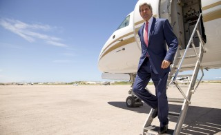U.S. Secretary of State John Kerry arrives at the airport in Mogadishu, Somalia on May 5, 2015. Photo by Andrew Harnik/Pool/Reuters