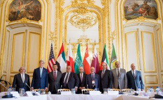 U.S. Secretary of State John Kerry (2nd L) poses for members of the media with foreign ministers of the Gulf Cooperation Council as they meet to discuss Middle East concerns about an emerging nuclear deal with Iran, at the Chief of Mission Residence in Paris, France, May 8, 2015. President Obama hopes to reassure the Gulf nation leaders that a nuclear deal with Iran with not destabilize the Middle East. Photo by Andrew Harnik/Pool/Reuters.