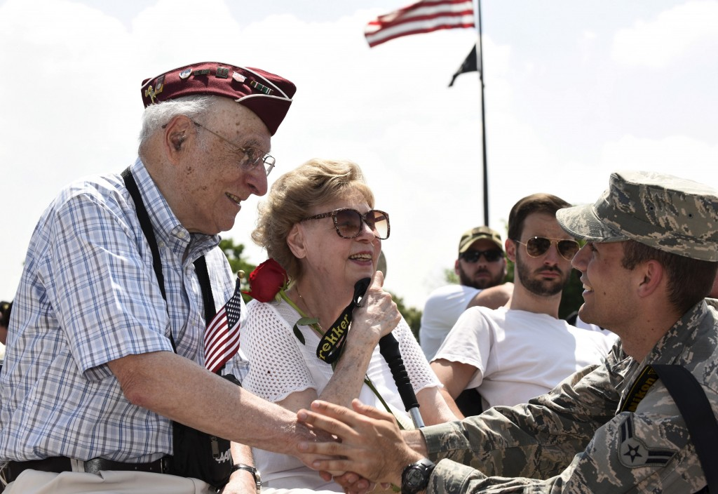 """Eli Linden, a World War II veteran and POW, interacts with a military photographer during a """"Capitol Flyover"""" over the National Mall to commemorate the 70th anniversary of VE (Victory in Europe) Day, in Washington, D.C. May 8, 2015. Photo by Sait Surkan Gurbuz/Reuters"""
