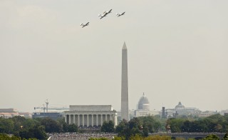 "P51-Mustangs take part in the ""Arsenal of Democracy World War II Victory Capitol Flyover"" above the National Mall to commemorate the 70th anniversary of VE (Victory in Europe) Day in Washington, D.C. May 8, 2015. Photo by Kevin Lamarque/Reuters"