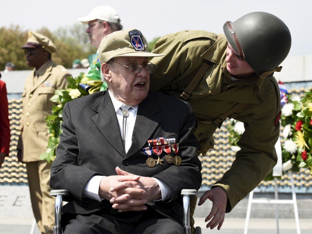 """A veteran interacts with an usher dressed in World War II era uniform during a """"Capitol Flyover"""" over the National Mall  to commemorate the 70th anniversary of VE (Victory in Europe) Day, in Washington May 8, 2015. Photo by Sait Serkan Gurbuz/Reuters"""