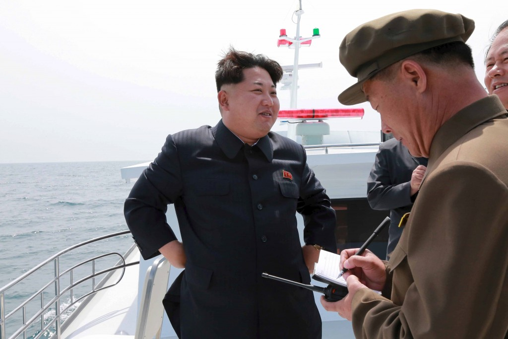 North Korean leader Kim Jong Un watches the test-fire of a strategic submarine underwater ballistic missile (not pictured), in this undated photo released by North Korea's Korean Central News Agency (KCNA) in Pyongyang on May 9, 2015. REUTERS/KCNA  ATTENTION EDITORS - THIS PICTURE WAS PROVIDED BY A THIRD PARTY. REUTERS IS UNABLE TO INDEPENDENTLY VERIFY THE AUTHENTICITY, CONTENT, LOCATION OR DATE OF THIS IMAGE. FOR EDITORIAL USE ONLY. NOT FOR SALE FOR MARKETING OR ADVERTISING CAMPAIGNS. THIS PICTURE IS DISTRIBUTED EXACTLY AS RECEIVED BY REUTERS, AS A SERVICE TO CLIENTS. NO THIRD PARTY SALES. SOUTH KOREA OUT. NO COMMERCIAL OR EDITORIAL SALES IN SOUTH KOREA	 - RTX1C7QU