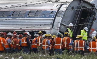 Rescue workers searched through the debris on Wednesday for more victims of an Amtrak passenger train wreck in Philadelphia that killed eight people and injured scores of others. Photo by Mike Segar/Reuters