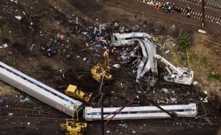 Emergency workers look through the remains from the wreck of the Amtrak train that derailed in Philadelphia last week on May 13, 2015. Photo by Lucas Jackson/Reuters
