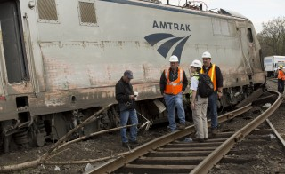 National Transportation Safety Board officials inspect the site of the Amtrak train derailment in Philadelphia in this NTSB handout photo on May 13. Photo courtesy of NTSB/Reuters